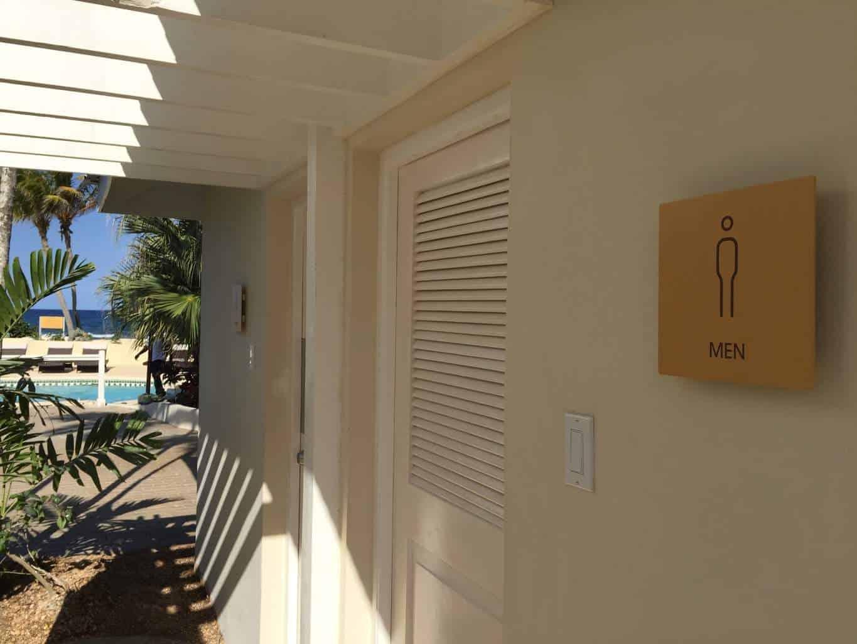 Bathroom signage for Melia Braco Village Resort
